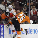 Philadelphia Flyers' Ryan White (25) collides with Calgary Flames' David Jones (19) during the first period of an NHL hockey game Tuesday, March 3, 2015, in Philadelphia. (AP Photo/Matt Slocum)