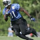 Detroit Lions wide receiver Calvin Johnson carries the ball during an NFL football training camp Saturday, July 28, 2012, in Allen Park, Mich. (AP Photo/Duane Burleson)