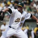 Oakland Athletics starting pitcher Jon Lester throws to the Los Angeles Angels during the first inning of a baseball game on Wednesday, Sept. 24, 2014, in Oakland, Calif. (AP Photo/Marcio Jose Sanchez)
