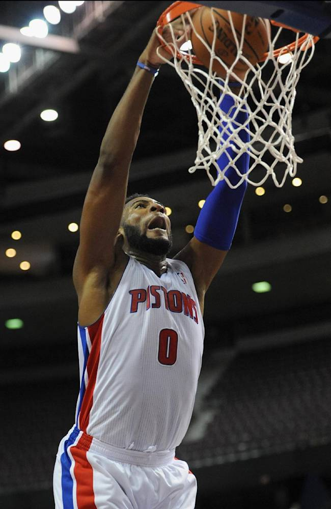 Detroit Pistons center Andre Drummond (0) dunks for two of his team high 17 points against Maccabi Haifa during the third quarter of an NBA preseason basketball game at the Palace of Auburn Hills, Mich., Tuesday, Oct. 8, 2013