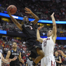San Diego State guard Xavier Thames (2) drives past Arizona forward Aaron Gordon (11) during the second half in a regional semifinal NCAA college basketball tournament game, Thursday, March 27, 2014, in Anaheim, Calif The Associated Press