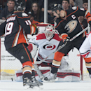 Carolina goaltender Anton Khudobin makes a save as the Ducks' Ryan Getzlaf and Patrick Maroon apply pressure during the second period of their hockey game at Honda Center Tuesday night Feb. 3, 2015 The Associated Press