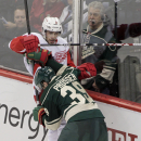 Detroit Red Wings left wing Drew Miller (20) battles along the boards with Minnesota Wild defenseman Nate Prosser (39) during the third period of an NHL hockey game, Saturday, March 22, 2014, in St. Paul, Minn. Detroit won 3-2 The Associated Press