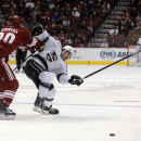 Arizona Coyotes defenseman Chris Summers (20), left, separates Los Angeles Kings defenseman Drew Doughty (8) from the puck in the first period during an NHL hockey game, Thursday, Dec. 4, 2014, in Glendale, Ariz The Associated Press