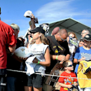 New Orleans Saints quarterback Drew Brees (9) signs autographs for fans during NFL football training camp in, White Sulphur Springs, W.Va., Saturday, July 26, 2014 The Associated Press