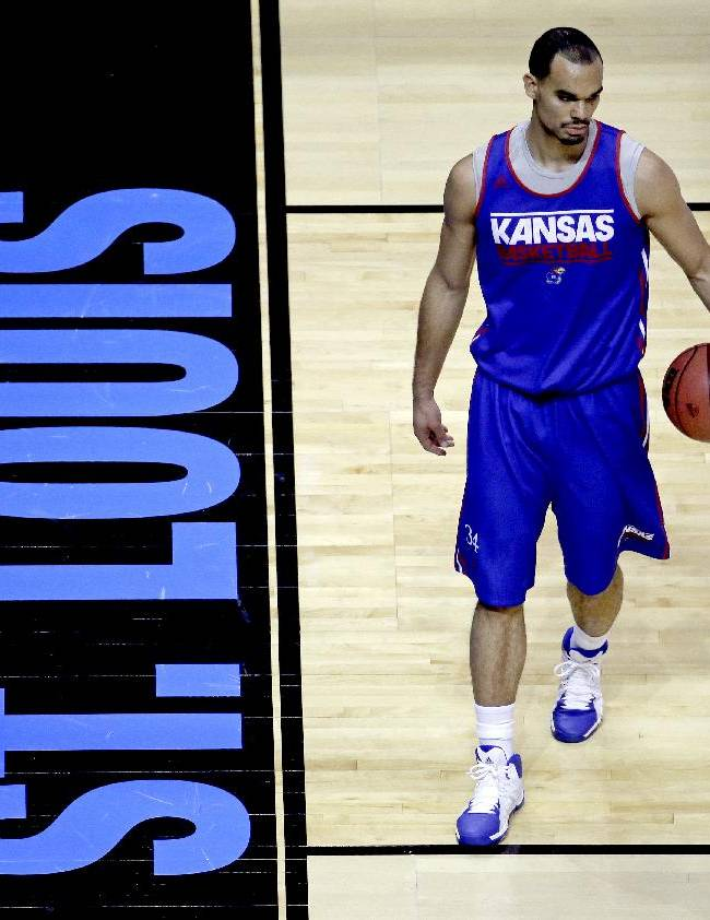 Kansas' Perry Ellis practices for the NCAA college basketball tournament Thursday, March 20, 2014, in St. Louis. Kansas is scheduled to play against Eastern Kentucky in a second-round game on Friday