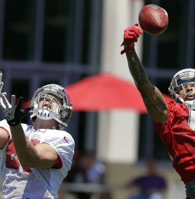 Tampa Bay Buccaneers safety Bradley McDougald, right, breaks up a pass intended for tight end Steve Maneri  during a voluntary minicamp NFL football practice Wednesday, April 23, 2014, in Tampa, Fla