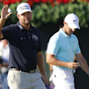 Sep 25, 2016; Atlanta, GA, USA; Ryan Moore reacts after putting the eighteenth as Rory McIlroy prepares to putt during regulation play in the final round of the Tour Championship at East Lake Golf Club. Mandatory Credit: Butch Dill-USA TODAY Sports