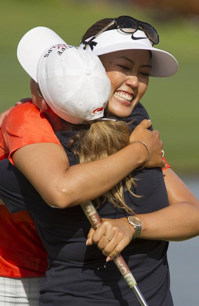 Cristie Kerr, left, gives Michelle Wie a hug celebrating Wie's win at the 2014 LPGA LOTTE Championship golf tournament at Ko Olina Golf Club, Saturday, April 19, 2014, in Kapolei, Hawaii