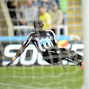 Newcastle United's Papiss Cisse misses an open goal during the English Premier League soccer match against Leicester City at St. James' Park, Newcastle, England, Saturday, Oct. 18, 2014