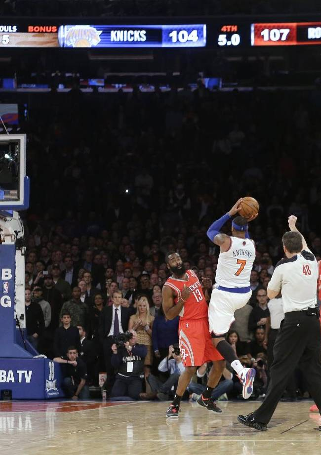 New York Knicks' Carmelo Anthony (7) shoots over Houston Rockets' James Harden (13) during the second half of an NBA basketball game Thursday, Nov. 14, 2013, in New York. The Rockets won 109-106. Harden fouled Anthony on the play