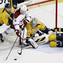 Phoenix Coyotes right wing Shane Doan (19) tries to get a shot away as he is defended by Nashville Predators defenseman Shea Weber (6), goalie Pekka Rinne (35), of Finland, and defenseman Roman Josi (59), of Switzerland, in the third period of an NHL hock