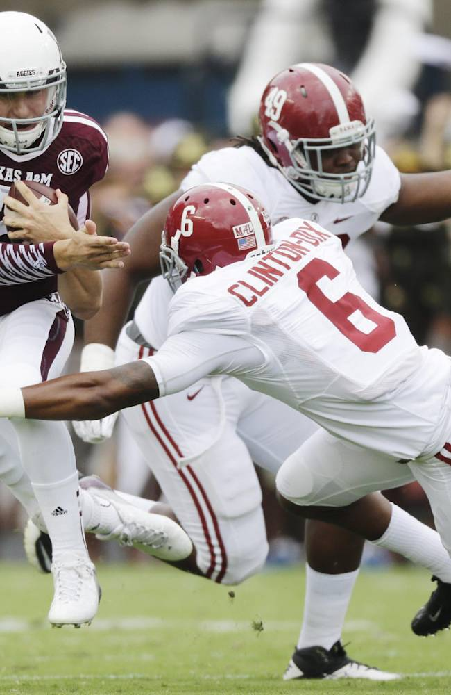Texas A&M quarterback Johnny Manziel (2) is tackled by Alabama defensive back Ha Ha Clinton-Dix (6) during the first quarter of an NCAA college football game Saturday, Sept. 14, 2013 in College Station, Texas