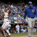 Arizona Diamondbacks catcher Tuffy Gosewisch, left, catches a pop-up by Chicago Cubs' Anthony Rizzo, right, who walks to the dugout during the first inning of a baseball game, Friday, May 22, 2015, in Phoenix. (AP Photo/Matt York)