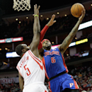 Detroit Pistons Josh Smith (6) drives to the basket on Houston Rockets' Jordan Hamilton (5) during the first half of an NBA basketball game, Saturday, March 1, 2014, in Houston The Associated Press