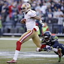 San Francisco 49ers quarterback Colin Kaepernick, left, rushes as Seattle Seahawks' Earl Thomas tackles him in the first half of an NFL football game, Sunday, Dec. 14, 2014, in Seattle The Associated Press