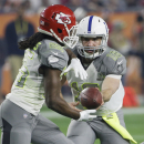 Indianapolis Colts' Andrew Luck hands off to Kansas City Chiefs' Jamaal Charles (25) during the first half of the NFL Football Pro Bowl Sunday, Jan. 25, 2015, in Glendale, Ariz The Associated Press