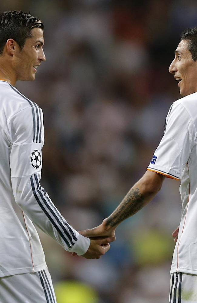 Real's Angel Di Maria, right is congratulated by Real's Cristiano Ronaldo after he scored during the Champions League group B soccer match between Real Madrid and FC Copenhagen at the Santiago Bernabeu stadium in Madrid, Wednesday, Oct. 2, 2013