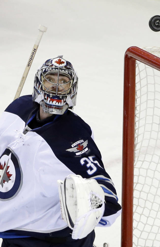 Enstrom's late goal helps Jets beat Sharks 4-3