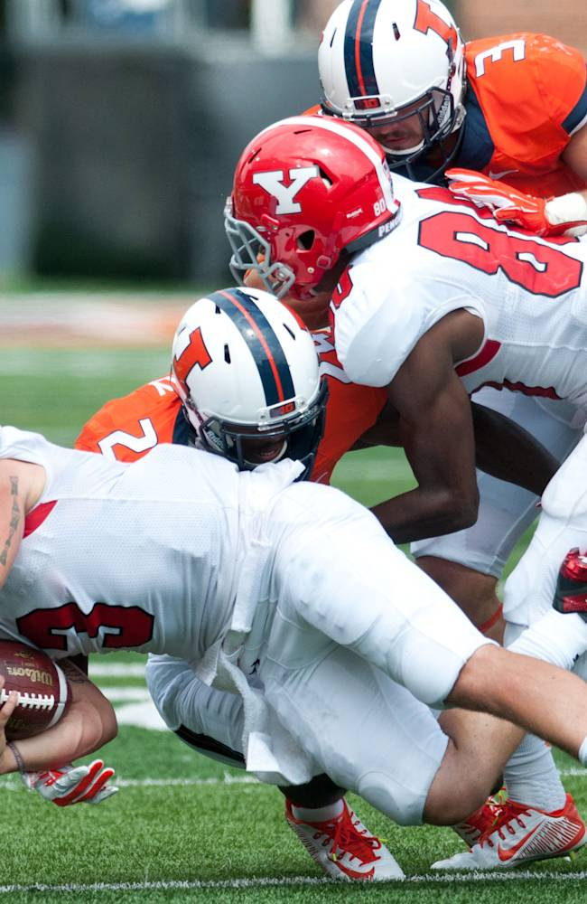 Youngstown State  quarterback Dante Nania (3) is tackled by Illinois defensive back Darius Mosely (24) during the third quarter of an NCAA college football game, Saturday, Aug. 30, 2014, at Memorial Stadium in Champaign, Ill