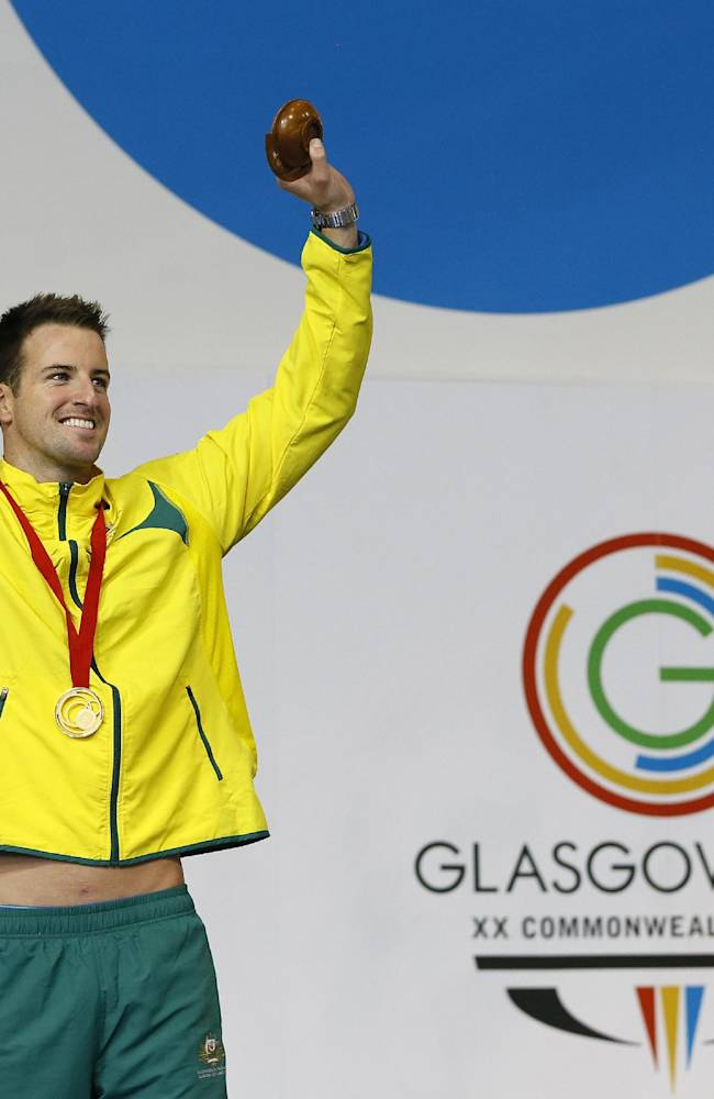 Australia's James Magnussen celebrates with the gold medal after winning the Men's 100m Freestyle swimming competition at the Tollcross International Swimming Centre during the Commonwealth Games 2014 in Glasgow, Scotland, Sunday July 27, 2014