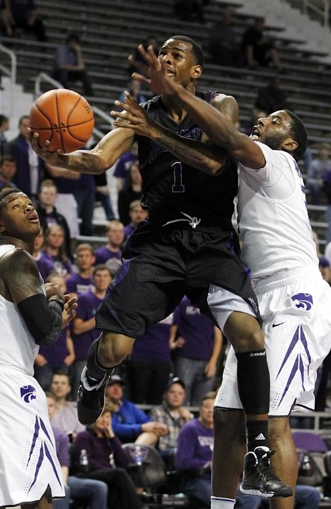 Central Arkansas guard DeShone McClure (1) attempts to score past Kansas State guards Marcus Foster, left, and Omari Lawrence, right, during the first half of an NCAA college basketball game in Manhattan, Kan, Sunday, Dec. 1, 2013