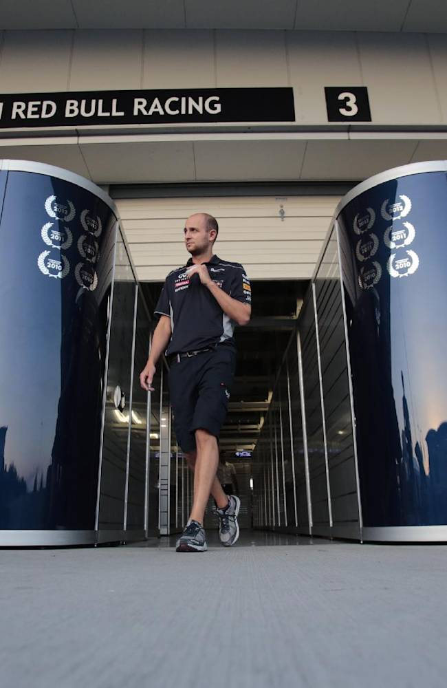 A Red Bull team member walks out of the team garage after qualifying for the Japanese Formula One Grand Prix, at the Suzuka circuit in Suzuka, Japan, Saturday, Oct. 12, 2013. Red Bull driver Mark Webber of Australia took pole position with team mate Sebastian Vettel of Germany qualifying second