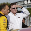 Team owner Richard Childress, right, chats with driver Ryan Newman before qualifications for Saturday's Sprint Cup auto race at Texas Motor Speedway in Fort Worth, Texas, Friday, April 10, 2015. (AP Photo/Tim Sharp)