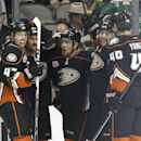 Anaheim Ducks right wing Emerson Etem, center, is congratulated by teammates, from left, Hampus Lindholm, Daniel Winnik, Patrick Maroon, and Nolan Yonkman (40) after scoring against Dallas Stars goalie Kari Lehtonen during the first period of an NHL hocke