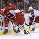 Columbus Blue Jackets center Brandon Dubinsky (17) and right wing Cam Atkinson (13) battle for the puck with Detroit Red Wings defenseman Kyle Quincey (27) during the first period of an NHL hockey game in Detroit, Tuesday, Dec. 16, 2014 The Associated Pre