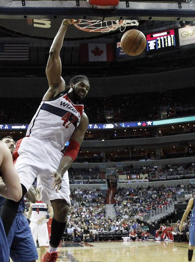 Washington Wizards forward Nene (42), from Brazil, dunks the ball in front of Minnesota Timberwolves forward Kevin Love (42) and guard Ricky Rubio (9), from Spain, in the second half of an NBA basketball game Tuesday, Nov. 19, 2013, in Washington. The Wizards won 104-100