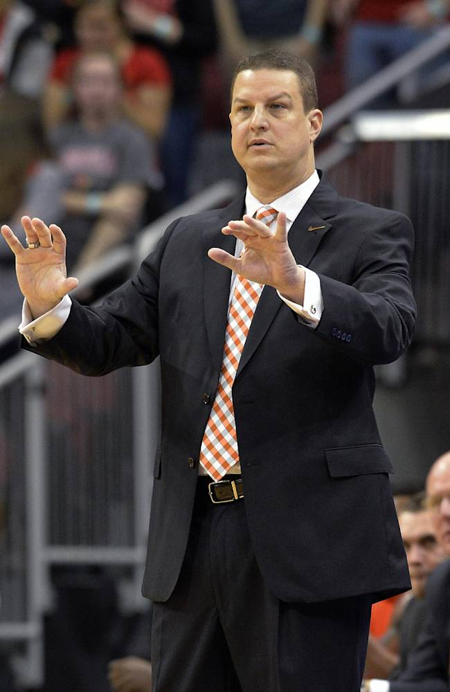 Pikeville coach Joe DeRosa talks to his players during the first half of an NCAA college basketball exhibition game against Louisville, Wednesday, Nov. 6, 2013, in Louisville, Ky