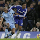 Chelsea's Loic Remy, right, competes for the ball with Manchester City's Vincent Kompany during the English Premier League soccer match between Chelsea and Manchester City at Stamford Bridge, London, Saturday, Jan. 31, 2015