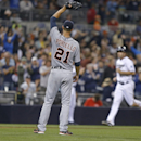 Detroit Tigers starting pitcher Rick Porcello watches San Diego Padres' Seth Smith head home on Chase Headley's home run off Porcello in the sixth inning of a baseball game Friday, April 11, 2014, in San Diego The Associated Press