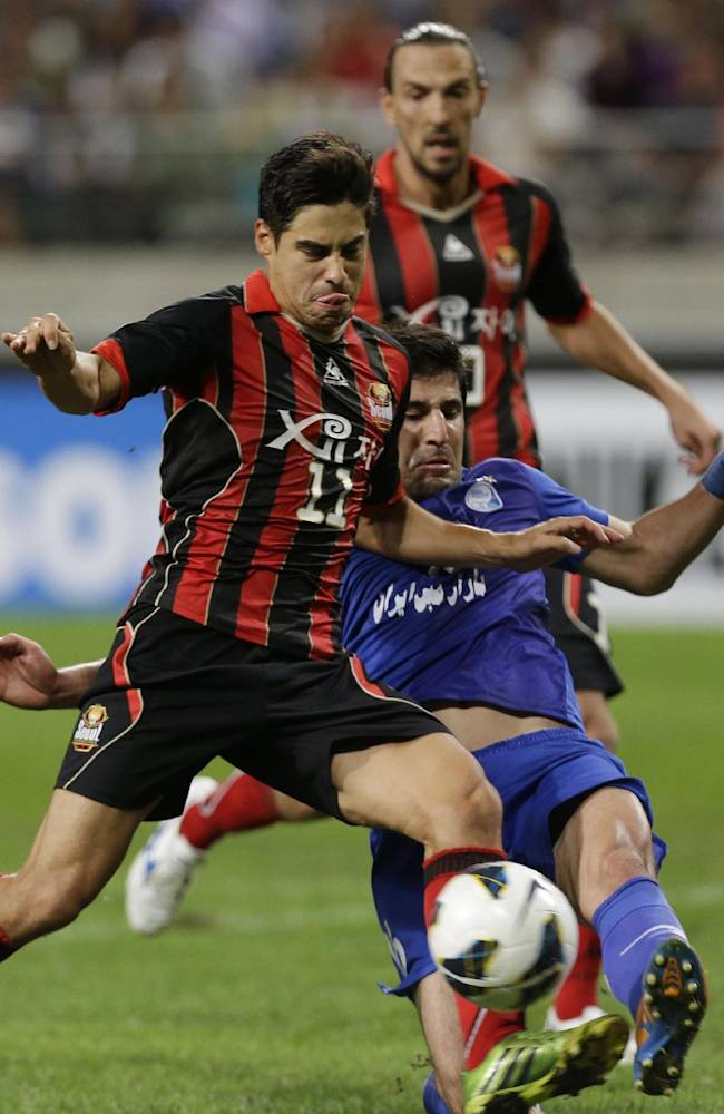 FC Seoul's Molina Uribe, front, fights for the ball against Iranian club Esteghlal's Hashem Beikzadeh during their 2013 Asian Champions League semifinal soccer match at Seoul World Cup Stadium in Seoul, South Korea, Wednesday, Sept. 25, 2013. FC Seoul won 2-0