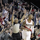 The crowd reacts after Portland Trail Blazers guard Damian Lillard, middle, sinks a three point shot late in the second half of an NBA basketball game against the Indiana Pacers in Portland, Ore., Monday, Dec. 2, 2013. Lillard scored 26 points as the Tra