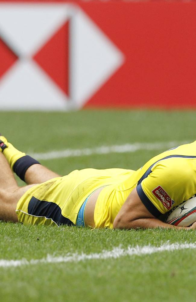 Australia's Paul Asquith runs a try during the quarterfinal match against Canada during the Hong Kong Sevens rugby tournament in Hong Kong, Sunday, March 30, 2014. Australia won 14-12
