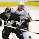 Pittsburgh Penguins' James Neal, left, is checked by Nashville Predators' Colin Wilson (33) during the third period of an NHL hockey game in Pittsburgh on Friday, Nov. 15, 2013. The Penguins won 4-1 The Associated Press