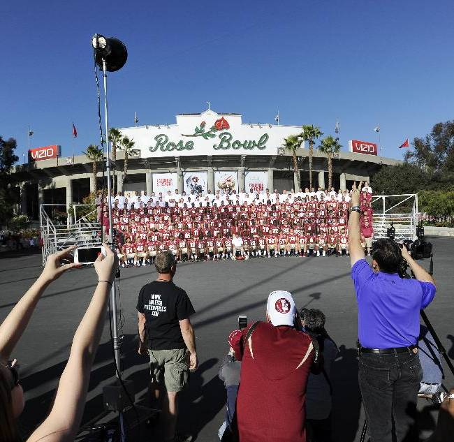 Florida State head coach Jimbo Fisher and the Seminole football team and staff pose for the official group photo outside the Rose Bowl in Pasadena, Calif., Sunday, Jan. 5, 2014. FSU will play Auburn in the BCS Championship NCAA college football game Jan. 6