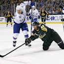 Boston Bruins center David Krejci (46) reaches for control of the puck against Tampa Bay Lightning right wing Ryan Callahan (24) during the second period of an NHL hockey game in Boston, Tuesday, Jan. 13, 2015. The Bruins won 4-3 The Associated Press