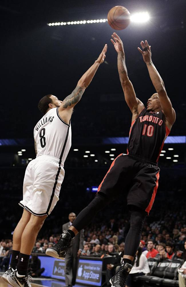 Toronto Raptors' DeMar DeRozan (10) shoots over Brooklyn Nets' Deron Williams (8) during the first half of Game 3 of an NBA basketball first-round playoff series Friday, April 25, 2014, in New York