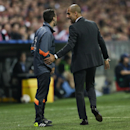 Bayern's head coach Pep Guardiola, right, talks with the fourth official Pau Cebrian Devis from Spain during the Champions League Group E soccer match between FC Bayern Munich and Manchester City at Allianz Arena in Munich, southern Germany, Wednesday Sep