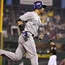 Pirates rally by Rockies 3-2 in 11 innings The Associated Press