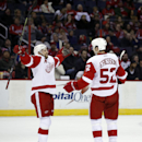 Detroit Red Wings defenseman Niklas Kronwall, left, from Sweden, and defenseman Jonathan Ericsson (52), also from Sweden, celebrate Ericsson's goal in the second period of an NHL hockey game against the Washington Capitals, Saturday, Jan. 10, 2015, in Was