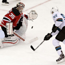 New Jersey Devils goalie Cory Schneider, left, makes a save on a penalty shot by San Jose Sharks center Tommy Wingels during the third period of an NHL hockey game, Saturday, Oct. 18, 2014, in Newark, N.J. The Sharks won 4-2 The Associated Press