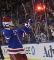 New York Rangers' Carl Hagelin, left, reacts after scoring during the second period of an NHL hockey game against the Minnesota Wild, Sunday, Dec. 22, 2013, in New York. (AP Photo/Seth Wenig)