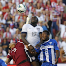 United States' Jozy Altidore (17) heads the ball as Honduras' goalie Noel Valladares (18) and teammate Jose Velasquez (5) defend in the second half during a World Cup qualifying soccer match at Rio Tinto Stadium on Tuesday, June 18, 2013, in Sandy, Utah. The United States defeated Honduras 1-0.  (AP Photo/Rick Bowmer)