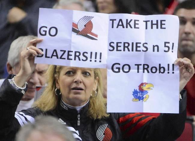 Portland Trail Blazers' supporter Brenda Mills holds up her sign during the first half of game four of an NBA basketball first-round playoff series game against the Houston Rockets in Portland, Ore., Sunday March 30, 2014
