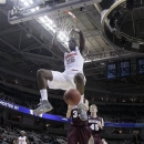 Syracuse forward Rakeem Christmas (25) dunks against Montana during the second half of a second-round game in the NCAA college basketball tournament in San Jose, Calif., Thursday, March 21, 2013. Syracuse won 81-34. (AP Photo/Jeff Chiu)