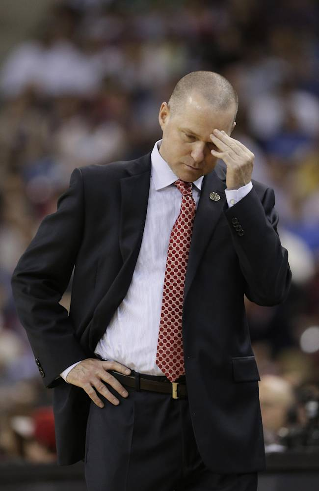 Sacramento Kings head coach Michael Malone rubs his forehead during the closing moments of the Kings 107-92 loss to the Oklahoma City Thunder in a NBA basketball game, Tuesday, April 8, 2014, in Sacramento, Calif